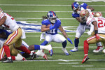 New York Giants' Devonta Freeman, center, carries the ball during the first half of an NFL football game against the San Francisco 49ers, Sunday, Sept. 27, 2020, in East Rutherford, N.J. (AP Photo/Bill Kostroun)