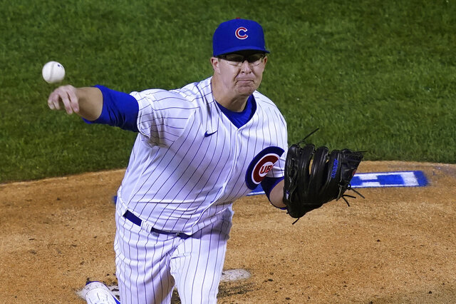 Chicago Cubs starting pitcher Alec Mills delivers during the first inning of the team's baseball game against the Cincinnati Reds on Tuesday, Sept. 8, 2020, in Chicago. (AP Photo/Charles Rex Arbogast)