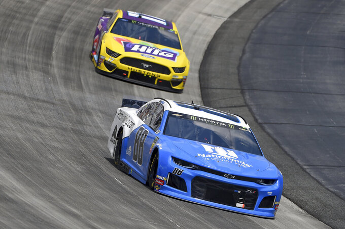 Alex Bowman (88) leads Ricky Stenhouse Jr. (17) during the NASCAR Cup Series auto race, Monday, May 6, 2019, at Dover International Speedway in Dover, Del. (AP Photo/Will Newton)