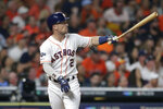 Houston Astros' Alex Bregman watches his solo home run against the Tampa Bay Rays during the fourth inning of Game 2 of a baseball American League Division Series in Houston, Saturday, Oct. 5, 2019. (AP Photo/Michael Wyke)