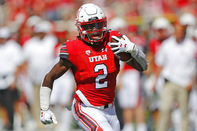 FILE - In this Sept. 14, 2019, file photo, Utah running back Zack Moss (2) carries the ball against Idaho State in the first half of an NCAA college football game, in Salt Lake City. Moss was selected to The Associated Press All-Pac 12 Conference team and tied for Pac-12 Offensive Player of the Year with Utah quarterback Tyler Huntley and Oregon tackle Penei Sewell, Thursday, Dec. 12, 2019.  (AP Photo/Rick Bowmer, File)