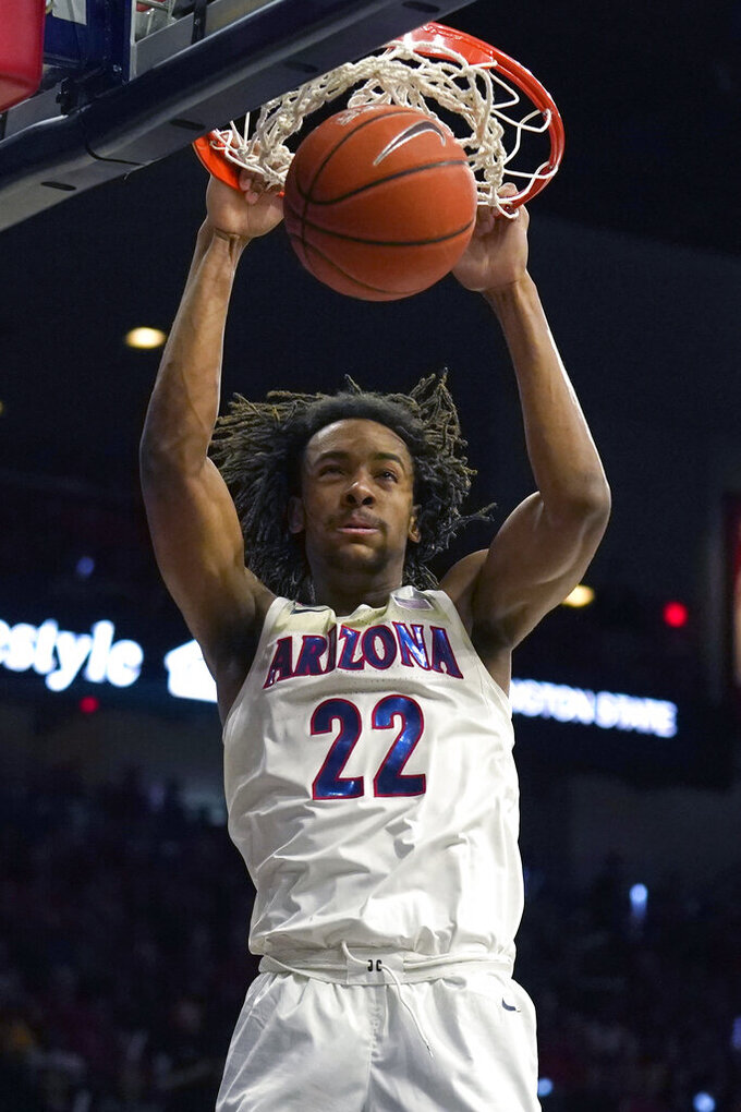 Arizona forward Zeke Nnaji dunks against Washington State during the second half of an NCAA college basketball game Thursday, March 5, 2020, in Tucson, Ariz. Arizona won 83-62. (AP Photo/Rick Scuteri)