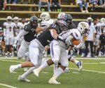 Hayes Maples, Southern Miss linebacker, tackles Ja'Won Howell, University of North Alabama Lions runningback, during their NCAA football game in Hattiesburg, Miss., Saturday, Nov. 7, 2020. (Cam Bonelli/Hattiesburg American via AP)