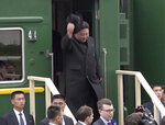 In this image from video released by Primorsky Regional Administration Press Service, North Korean leader Kim Jong Un gets off a train upon arrival at Khasan train station in Primorye region, Russia, Wednesday, April 24, 2019. Kim arrived in Russia by train on Wednesday, a day before his much-anticipated summit with Russian President Vladimir Putin that comes amid deadlocked diplomacy on his nuclear program. (Primorsky Regional Administration Press Service via AP)