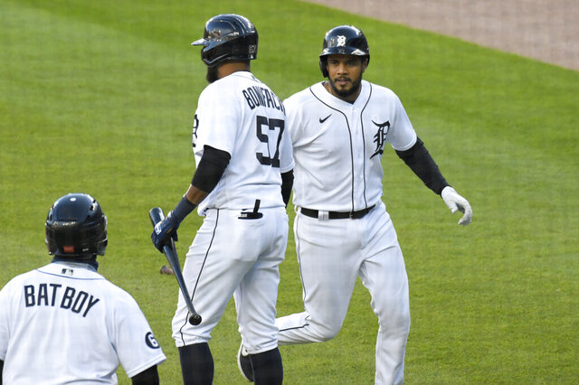 Detroit Tigers' Jeimer Candelario, right, is congratulated by Jorge Bonifacio after scoring a run against the Cleveland Indians in the first inning of a baseball game Saturday, Sept. 19, 2020, in Detroit. (AP Photo/Jose Juarez)
