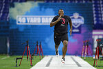 Auburn defensive lineman Derrick Brown runs the 40-yard dash at the NFL football scouting combine in Indianapolis, Saturday, Feb. 29, 2020. (AP Photo/Michael Conroy)