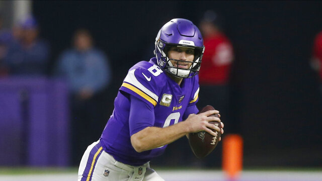 FILE - In this Nov. 17, 2019, file photo, Minnesota Vikings NFL quarterback Kirk Cousins throws against the Denver Broncos during an NFL football game in Minneapolis. The Vikings and Cousins have agreed to a two-year contract extension. Cousins' agent Mike McCartney made the announcement on his verified Twitter account. T (AP Photo/Jim Mone,File