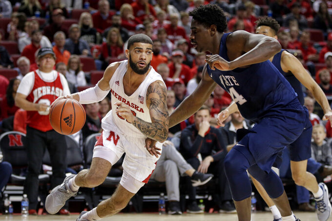Nebraska's Haanif Cheatham, left, drives to the basket against Penn State's Mike Watkins (24) during the first half of an NCAA college basketball game in Lincoln, Neb., Saturday, Feb. 1, 2020. (AP Photo/Nati Harnik)