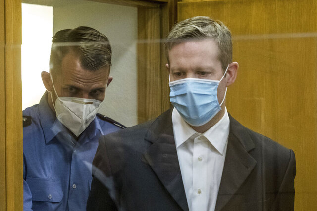 Defendant Stephan Ernst, right, who is accused of murdering politician Walter Luebcke he arrives for the first day of his trial at the Oberlandgericht Frankfurt courthouse, in Frankfurt, Germany, Tuesday, June 16, 2020. A German court will begin hearing the case against two far-right extremists accused of killing the regional politician Walter Luebcke of Merkel's Christian Democratic Union party. The execution-style slaying of Walter Luebcke shocked the country last year. Stephan Ernst a 46-year-old with previous convictions for violent anti-migrant crimes, will appear in the Frankfurt regional court accused of murder, attempted murder, serious bodily harm and firearms offenses. A second man, identified only as Markus H. due to privacy rules, is charged with accessory to murder and breaking firearms laws.  (Thomas Lohnes/Pool via AP)