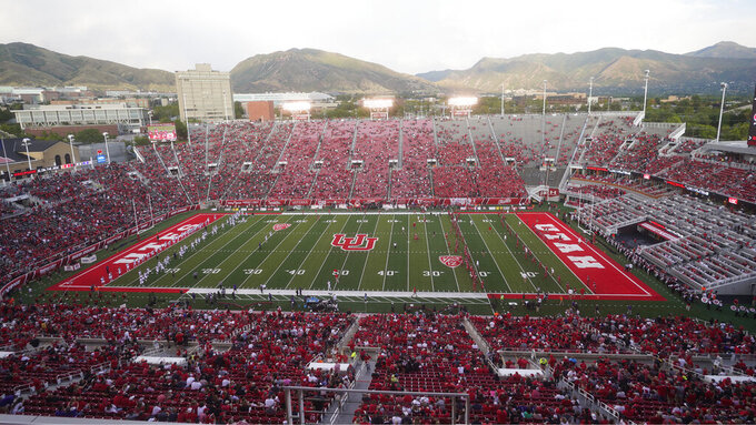 Fans at Rice-Eccles Stadium wait for the start of an NCAA college football game between Weber State and Utah on Thursday, Sept. 2, 2021, in Salt Lake City. (AP Photo/Rick Bowmer)