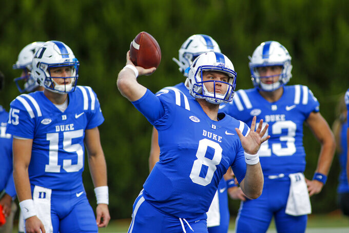 Duke quarterback Chase Brice (8)  warms up before playing against Virginia Tech in an NCAA college football game, Saturday, Oct. 3, 2020, in Durham, N.C.  (Nell Redmond/Pool Photo via AP)