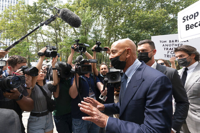 Tom Barrack, center, leaves Brooklyn federal court, Monday, July 26, 2021 in New York. Barrack was among three men charged in New York federal court with trying to influence foreign policy while Donald Trump was running in 2016 and later while president. The chair of former President Donald Trump's 2017 inaugural committee allegedly conspired to influence U.S. policy to benefit the United Arab Emirates, even while he was seeking a position as an American diplomat. (AP Photo/Mark Lennihan)