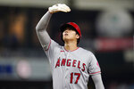 Los Angeles Angels' Shohei Ohtani watches a foul ball as he stands on first base during the eighth inning of a baseball game against the San Diego Padres, Tuesday, Sept. 7, 2021, in San Diego. (AP Photo/Gregory Bull)