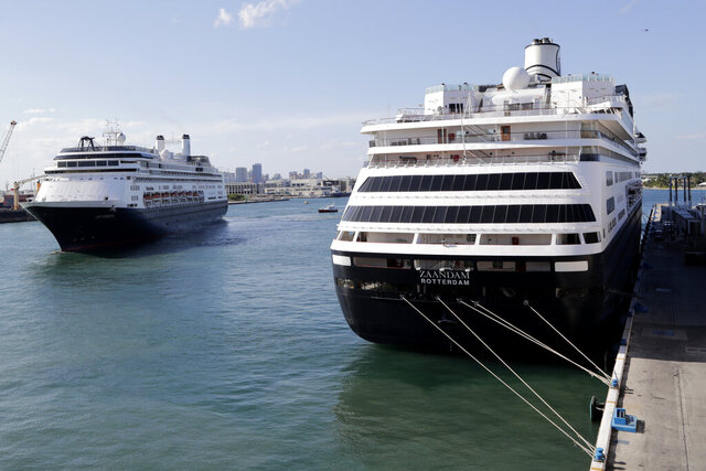 Carnival's Holland America cruise ship Rotterdam, left, arrives at Port Everglades as the Zaandam, right, is docked during the new coronavirus pandemic, Thursday, April 2, 2020, in Fort Lauderdale, Fla. Those passengers that are fit for travel in accordance with guidelines from the U.S. Centers for Disease Control will be permitted to disembark. (AP Photo/Lynne Sladky)