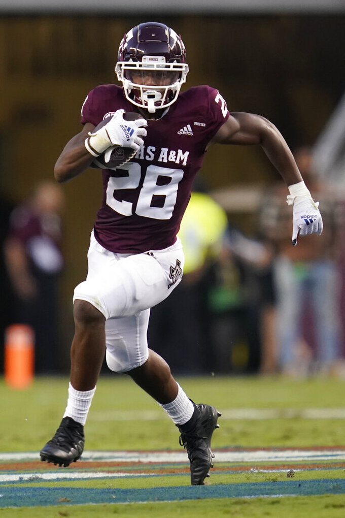 Texas A&M running back Isaiah Spiller (28) breaks to the outside against Kent State for a first down run during the first quarter of an NCAA college football game on Saturday, Sept. 4, 2021, in College Station, Texas. (AP Photo/Sam Craft)