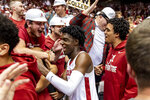 FILE - In this Jan. 15, 2020, file photo, Alabama guard Kira Lewis Jr. greets fans after an NCAA college basketball game against Auburn in Tuscaloosa, Ala. Lewis Jr. was selected to the Associated Press All-SEC first team announced Tuesday, March 10, 2020. (AP Photo/Vasha Hunt, File)