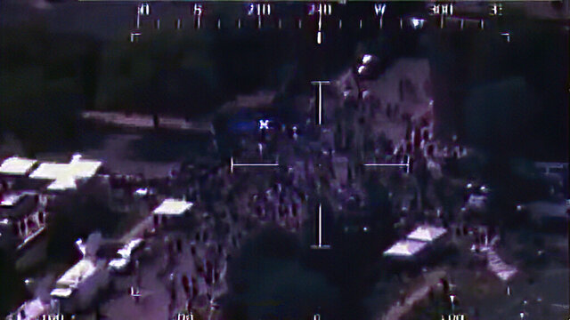 This image from video released by the Department of Defense show a scene on a street as captured by a RC-26 flying over Minneapolis, on June 4, 2020. A Pentagon reports concludes that the use of National Guard reconnaissance planes in four U.S. cities to monitor the widespread protests earlier this year didn't violate rules against the military collecting intelligence on Americans. The investigation by the Air Force inspector general found that the planes were used to gather information about crowd size, crowd flows and fires but they did not monitor individuals. (Department of Defense via AP)