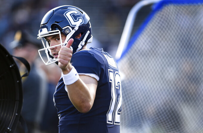 Connecticut quarterback Mike Beaudry (12) gives a thumbs-up as he heads out onto the field at the start of the team's NCAA college football game against Wagner on Thursday, Aug. 29, 2019, in East Hartford, Conn. (AP Photo/Stephen Dunn)