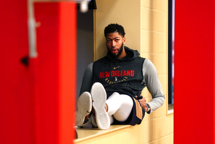 New Orleans Pelicans forward Anthony Davis waits to talk to reporters after their NBA basketball practice in Metairie, La., Friday, Feb. 1, 2019. (AP Photo/Gerald Herbert)