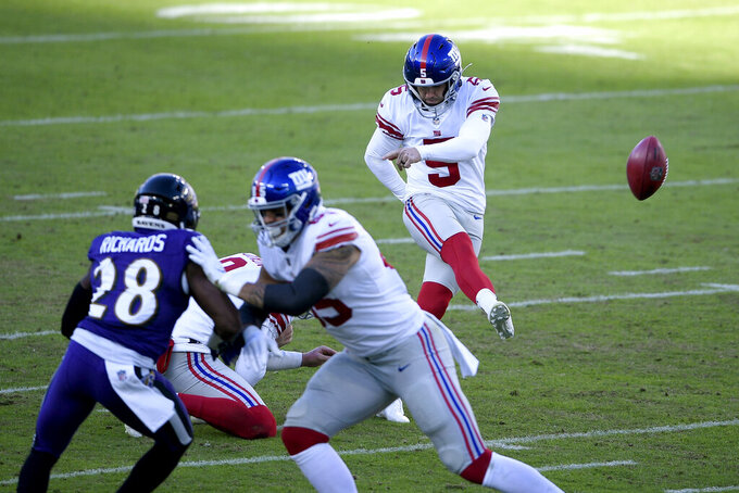 FILE - In this Dec. 27, 2020, file photo, New York Giants kicker Graham Gano (5) kicks a field goal against the Baltimore Ravens during the first half of an NFL football game in Baltimore. Gano had an outstanding year making 31 of 32 field goal attempts including his last 30.  (AP Photo/Nick Wass, File)