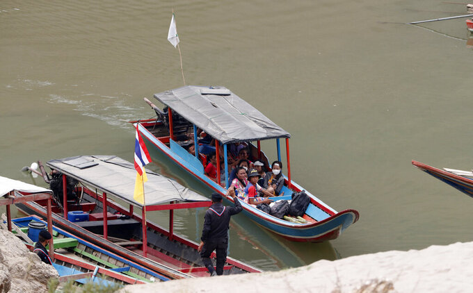 Karenni villagers from Myanmar arrive on a boat with an injured person as they evacuate to Ban Mae Sam Laep Health Center in Mae Hong Son province, northern Thailand on Tuesday March 30, 2021. Thai soldiers began sending back some of the thousands of people who have fled a series of airstrikes by the military in neighboring Myanmar, people familiar with the matter said Monday. But Thai officials denied that as the insecurity on the border added a new dimension to an already volatile crisis set off by a coup in Myanmar. (AP Photo/Sakchai Lalit)