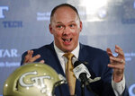 FILE - In this Dec. 7, 2018, file photo, newly hired Georgia Tech football coach Geoff Collins speaks during a news conference in Atlanta. Georgia Tech could face some significant growing pains with a roster full of players recruited to run the triple-option offense favored by retired coach Paul Johnson _ not the more traditional scheme run by Collins. (AP Photo/John Bazemore, File)