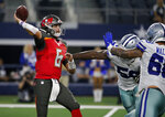 Tampa Bay Buccaneers quarterback Vincent Testaverde (6) throws a pass under pressure from Dallas Cowboys' Chris Covington, center, and Ricky Walker, right, in the second half of a preseason NFL football game in Arlington, Texas, Thursday, Aug. 29, 2019. (AP Photo/Michael Ainsworth)