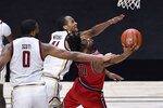 St. John's Posh Alexander, right, is fouled by Boston College's Frederick Scott, left, as Boston College's Steffon Mitchell, back, defends in the first half of an NCAA college basketball game, Monday, Nov. 30, 2020, in Uncasville, Conn. (AP Photo/Jessica Hill)