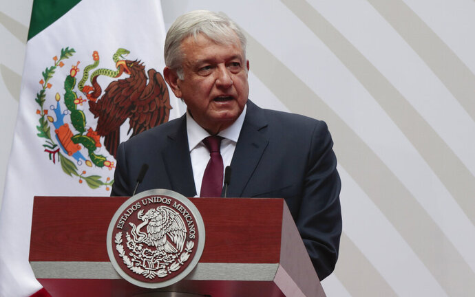 FILE - In this April 5, 2020 file photo, Mexican President Andres Manuel Lopez Obrador speaks at the National Palace in Mexico City. For his first foreign trip as president, López Obrador travels to Washington Tuesday, July 7, 2020 to meet with President Donald Trump. (AP Photo/Eduardo Verdugo, File)