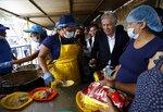 Organization of American States Secretary-General Luis Almagro talks to Venezuelan migrants at the