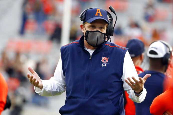 FILE - Auburn head coach Gus Malzahn reacts to a call during the second half of an NCAA college football game against LSU in Auburn, Ala., in this Saturday, Oct. 31, 2020, file photo. It's been a whirlwind three weeks for Auburn, given longtime coach Gus Malzahn getting fired on Dec. 13, new coach Bryan Harsin being introduced 11 days later, several players opting out of the Citrus Bowl and the Tigers hurriedly trying to prepare for a showdown against a stout Northwestern defense. (AP Photo/Butch Dill, File)