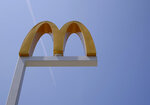 FILE- This Aug. 8, 2018, file photo shows the logo of McDonald's at flagship restaurant in Chicago. McDonald's workers are going on strike next week. Emboldened by the #MeToo movement, McDonald's workers have voted to stage a one-day strike next week at restaurants in 10 cities. Plans are for the walkout to start lunchtime on Sept. 18. (AP Photo/Nam Y. Huh, File)