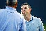 Rory McIlroy, of Northern Ireland, right, congratulates Matt Kuchar after their round during the second round of The Players Championship golf tournament Friday, March 15, 2019, in Ponte Vedra Beach, Fla. (AP Photo/Gerald Herbert)