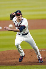 Atlanta Braves starting pitcher Max Fried fields a ground ball off the bat of Miami Marlins' Starling Marte in the first inning of a baseball game Wednesday, Sept. 23, 2020, in Atlanta. (AP Photo/John Bazemore)