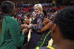 Baylor's Queen Egbo (25) picks up coach Kim Mulkey after the team's NCAA college basketball game against Texas Tech, Tuesday, Feb. 18, 2020, in Lubbock, Texas. Mulkey won her 600th career game in Baylor's 77-62 victory over Texas Tech. (AP Photo/Brad Tollefson)