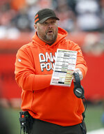 FILE - In this Dec. 23, 2018, file photo, Cleveland Browns offensive coordinator Freddie Kitchens is shown before an NFL football game against the Cincinnati Bengals, in Cleveland. A person familiar with the decision says the Cleveland Browns are hiring Freddie Kitchens as their coach.  Kitchens, who had a dazzling eight-week run as the team's interim offensive coordinator, is finalizing his contract and will be named Cleveland's ninth coach since 1999, said the person who spoke Wednesday, Jan. 9, 2019, to the Associated Press on condition of anonymity because the team is not commenting on the imminent hire. (AP Photo/Ron Schwane, File)