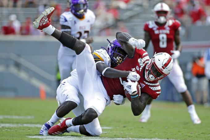 East Carolina defensive back Ja'Quan McMillian (21) tackles North Carolina State wide receiver Emeka Emezie (3) during the second half of an NCAA college football game in Raleigh, N.C., Saturday, Aug. 31, 2019. (AP Photo/Gerry Broome)
