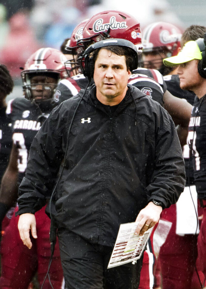 FILE - In this Dec. 1, 2018, file photo, South Carolina head coach Will Muschamp walks across the field during an NCAA college football game against Akron in Columbia, S.C. Muschamp's Gamecocks want to the have a strong finish to their season when they take on Virginia at the Belk Bowl next week. (AP Photo/Sean Rayford, File)