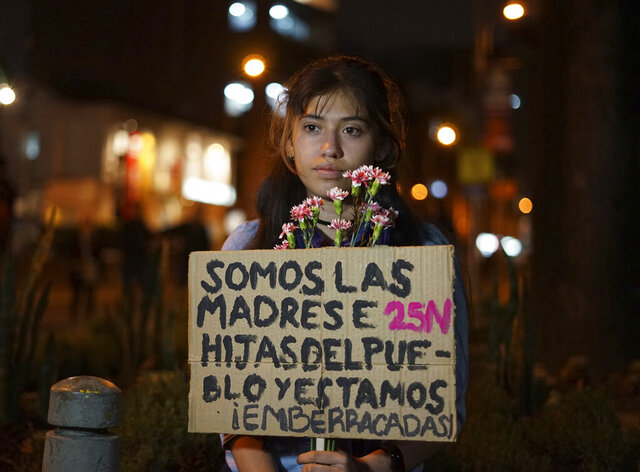 """Ana Maria Moya takes part in a march for International Day for the Elimination of Violence against Women, in Bogota, Colombia, Monday, Nov. 25, 2019. The 19-year-old college student said she's been robbed numerous times, regularly experiences street harassment and is frustrated by a system where most crimes go unpunished and women deal with chauvinism and inequality. """"I'm upset because life in Colombia has been difficult,"""" she said. (AP Photo/Christine Armario)"""