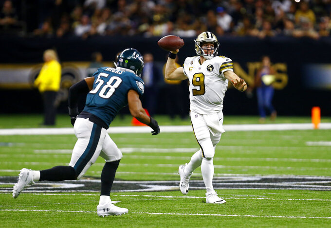 New Orleans Saints quarterback Drew Brees (9) passes in the second half of an NFL football game against the Philadelphia Eagles in New Orleans, Sunday, Nov. 18, 2018. (AP Photo/Butch Dill)