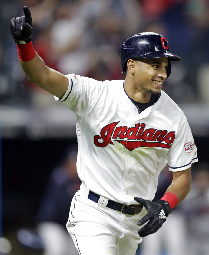 Cleveland Indians' Oscar Mercado celebrates after hitting a game-winning RBI-single off Cincinnati Reds relief pitcher Raisel Iglesias in the tenth inning in a baseball game, Tuesday, June 11, 2019, in Cleveland. Mike Freeman scored on the play. The Indians won 2-1 in ten innings. (AP Photo/Tony Dejak)