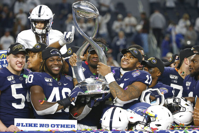 Penn State celebrates following the team's 53-39 win over Memphis in the NCAA Cotton Bowl college football game, Saturday, Dec. 28, 2019, in Arlington, Texas. (AP Photo/Ron Jenkins)