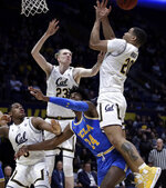 California's Matt Bradley, right, reaches for a rebound with Connor Vanover (23) over UCLA's Jalen Hill (24) during the first half of an NCAA college basketball game Wednesday, Feb. 13, 2019, in Berkeley, Calif. (AP Photo/Ben Margot)