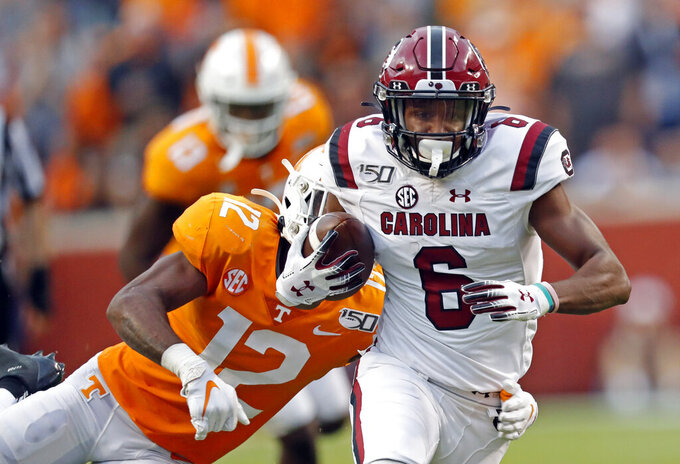 South Carolina wide receiver Josh Vann (6) escapes from Tennessee defensive back Shawn Shamburger (12) in the first half of an NCAA college football game Saturday, Oct. 26, 2019, in Knoxville, Tenn. (AP Photo/Wade Payne)