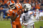 FILE - In this Dec. 7, 2019, file photo, Clemson wide receiver Tee Higgins (5) catches a pass while Virginia cornerback Nick Grant (1) defends during the second half of the Atlantic Coast Conference championship NCAA college football game in Charlotte, N.C. The NFL's shutdown because of the coronavirus pandemic is denying teams the opportunity to get face time with draft prospects who have been injured, have checkered pasts or are under the radar. Higgins' 6-foot-4 frame and superb hands stand out in a deep pool of receivers. Speed is the question, and a private workout might have helped. (AP Photo/Mike McCarn, File)