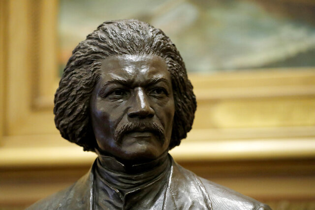 A bronze statue of abolitionist Frederick Douglass is seen during a private viewing ahead of its unveiling at the Maryland State House, Monday, Feb. 10, 2020, in Annapolis. The statue, along with a statue of Harriet Tubman, will be unveiled Monday night in the Old House Chamber, the room where slavery was abolished in Maryland in 1864. (AP Photo/Julio Cortez)