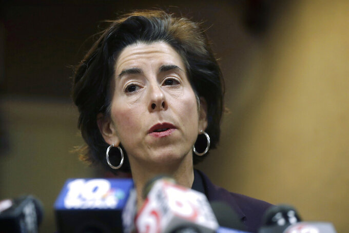 FILE - In this March 1, 2020 file photo, Rhode Island Gov. Gina Raimondo faces reporters during a news conference, in Providence, R.I. In a letter to Raimondo Tuesday, Jan. 19, 2021, a First Amendment rights organization with the backing of journalists' organizations is asking her to resume full media briefings and respond to direct questioning from reporters during those briefings. The Democratic governor has held one news conference but has not made herself available for questioning from journalists since she was nominated to serve as commerce secretary in the Joe Biden administration. (AP Photo/Steven Senne, File)