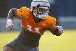 FILE - In this Aug. 9, 2019, file photo, Tennessee freshman linebacker Henry To'o To'o runs a drill during an NCAA college football practice in Knoxville, Tenn. Tennessee already has a freshman linebacker tied for the team lead in tackles, and the Volunteers plan to rely more on their younger players as they attempt to recover from their worst start in over three decades  (Saul Young/Knoxville News Sentinel via AP, File)