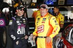 Jimmie Johnson, left, meets with Ryan Newman in the garage before practice for a NASCAR cup series auto race at Michigan International Speedway, Friday, June 7, 2019, in Brooklyn, Mich. (AP Photo/Carlos Osorio)