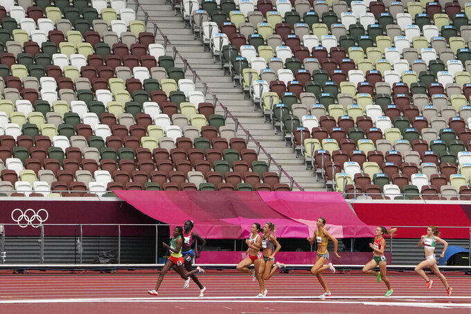 Athing Mu, of United States, wins a heat in the women's 800-meter run at the 2020 Summer Olympics, Friday, July 30, 2021, in Tokyo. (AP Photo/Charlie Riedel)